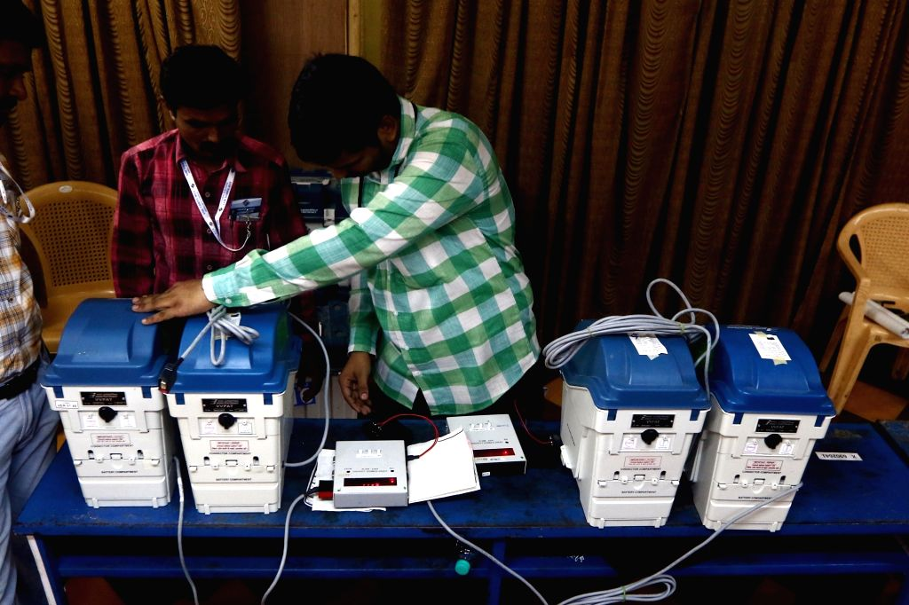 Chennai: Voter-verified paper audit trail (VVPAT) machines being checked by election officials during 2019 Lok Sabha elections, in Chennai on April 11, 2019. (Photo: IANS)