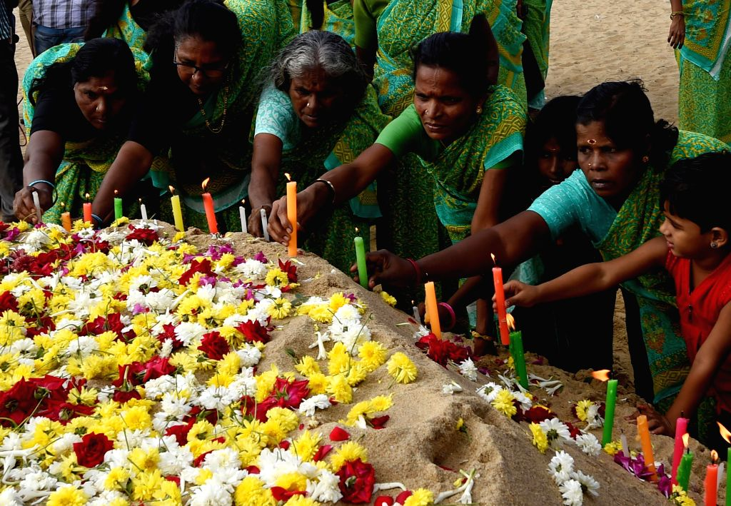 Women offer prayers at Marina Beach on the 10th Anniversary of the 2004 Tsunami in Chennai, on Dec. 26, 2014.