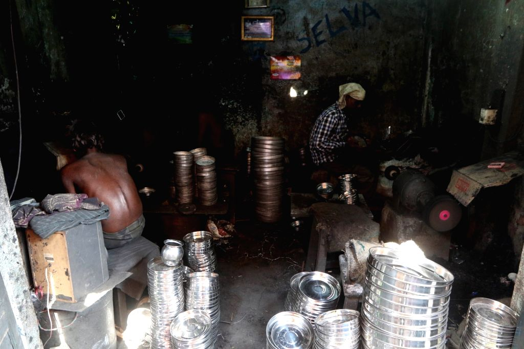 Chennai: Workers busy shaping aluminium into utensils at a utensils factory unit in Chennai on May 1, 2018. May 1 is observed as International Labour Day. (Photo: IANS)