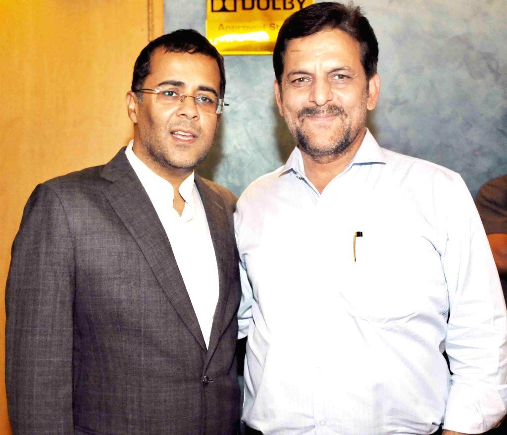 Chetan Bhagat with Rakesh Madhotra ceo nadiad wala grandson during special screening of film 2 States at YRF Studios in Mumbai on April 17, 2014.