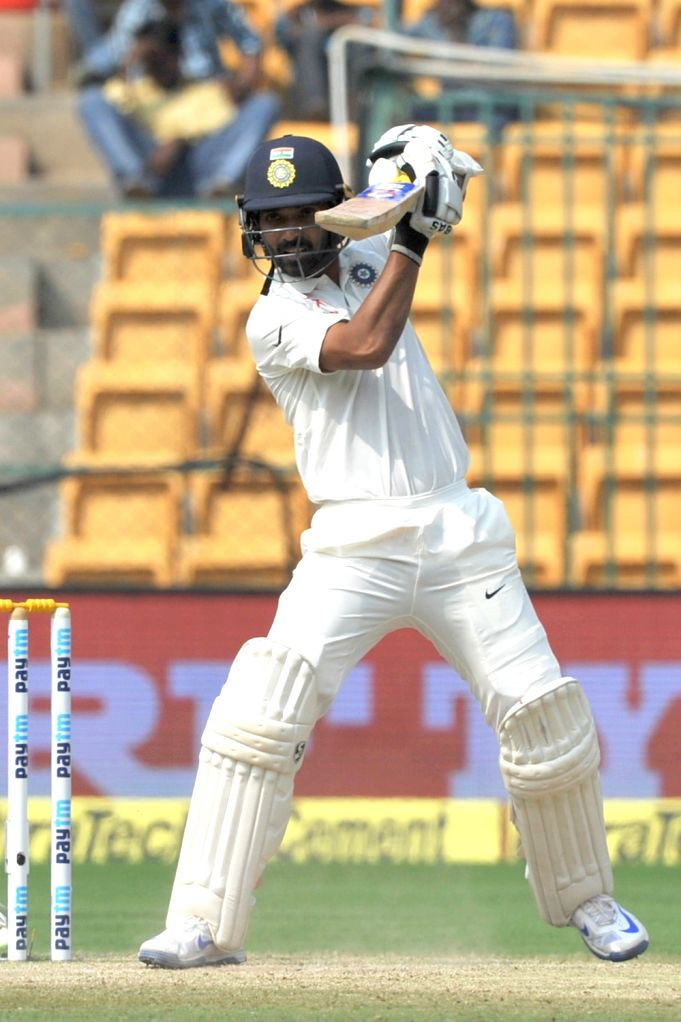 Cheteshwar Pujara celebrates his half century during the third day of the second test match between India and Australia at M. Chinnaswamy Stadium in Bengaluru on March 6, 2017. (Photo: ...
