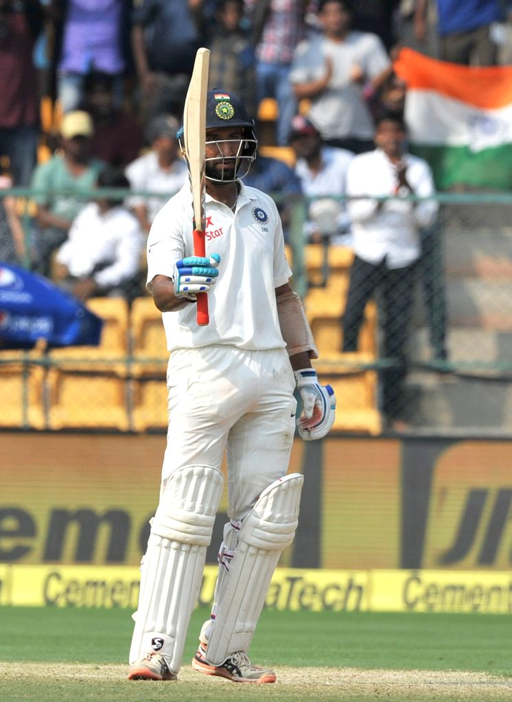 Cheteshwar Pujara of India celebrates his half century during the third day of the second test match between India and Australia at M. Chinnaswamy Stadium in Bengaluru on ​March 6, 2017. ...