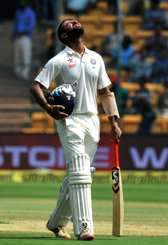 Cheteshwar Pujara of India reacts after getting dismissed at 92 runs during the fourth day of the second test match between India and Australia at M. Chinnaswamy Stadium in Bengaluru on ...
