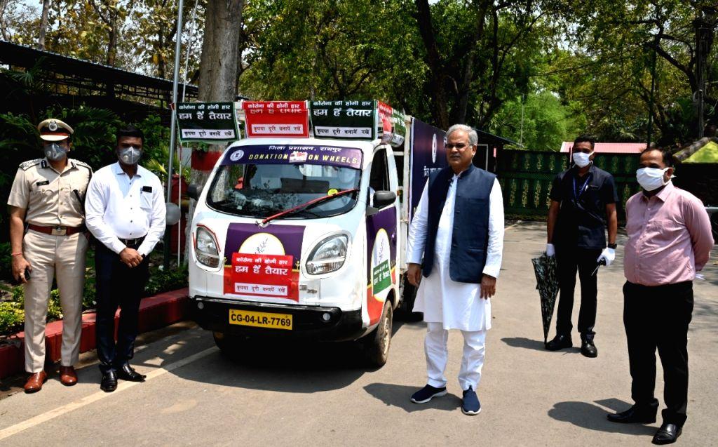 Chhattisgarh Chief Minister Bhupesh Baghel flags of donation on wheal in Raipur. - Bhupesh Baghel