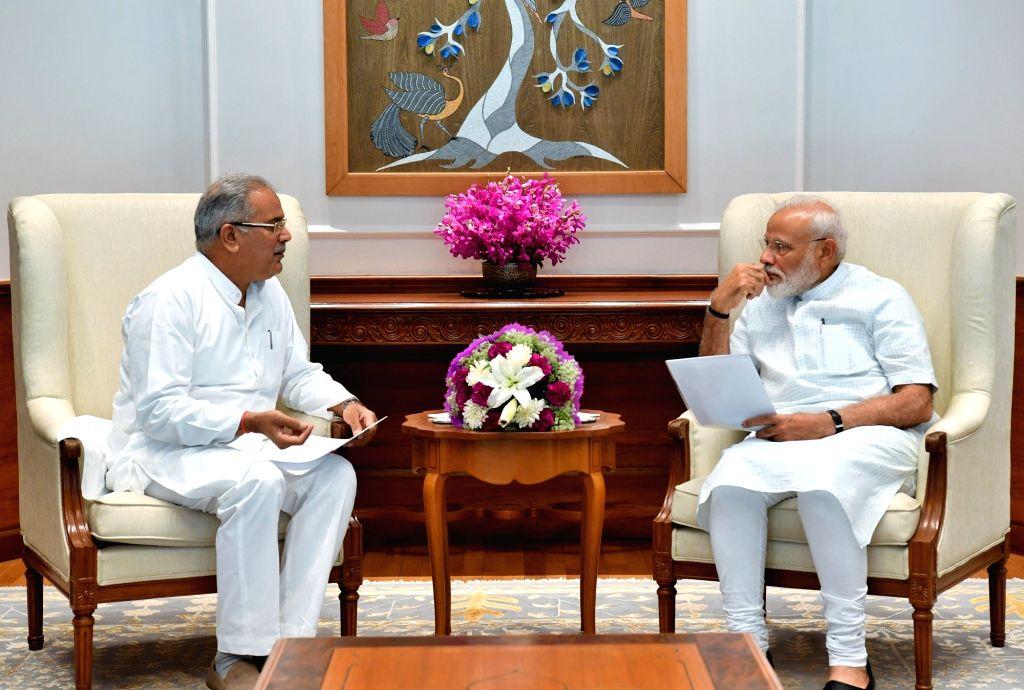 Chhattisgarh Chief Minister Bhupesh Baghel meets Prime Minister Narendra Modi, in New Delhi on June 15, 2019. - Bhupesh Baghel and Narendra Modi