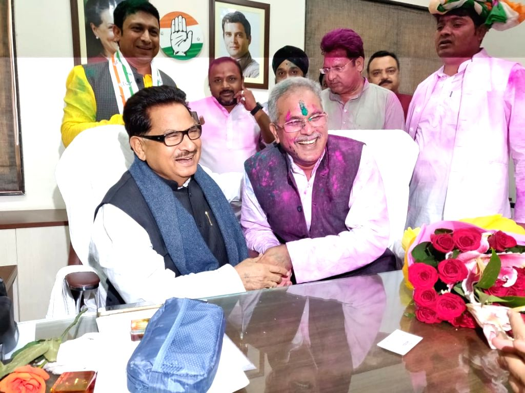 Chhattisgarh Congress president Bhupesh Baghel and party leader P.L. Punia celebrate at the party office after the party swept Chhattisgarh Assembly elections, in Raipur on Dec 11, 2018.
