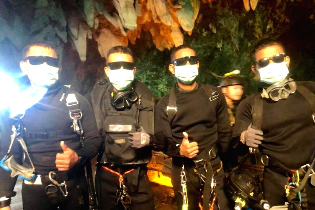 CHIANG RAI, July 10, 2018 - Photo released by Royal Thai Navy on July 10, 2018 shows the last four Thai Navy SEAL divers coming out safely after completing the rescue mission inside the Tham Luang ... - Chiang Rai Province