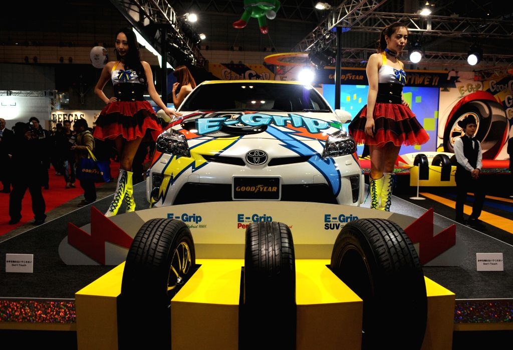 Models pose by a customized car during the Tokyo Auto Salon at Makuhari Messe in Chiba, Japan, Jan. 9, 2015.