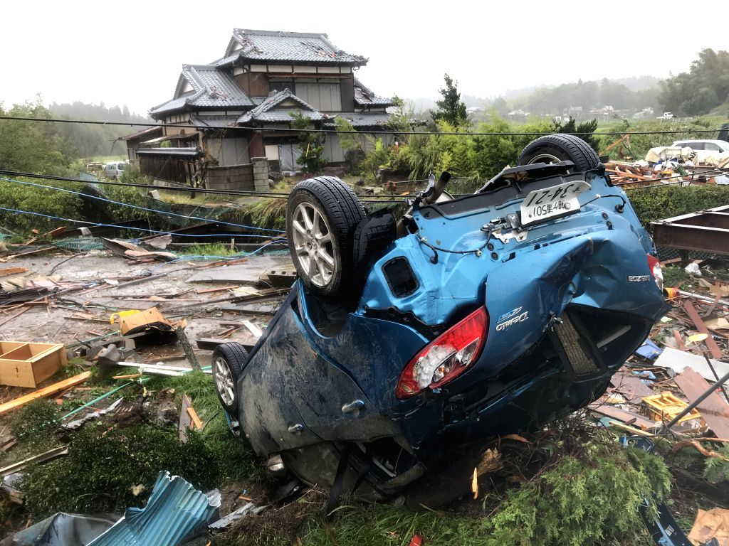 CHIBA, Oct. 12, 2019 - A car is overturned after a tornado hit Chiba Prefecture near Tokyo, Japan, on Oct. 12, 2019. A tornado formed during the course of the Typhoon Hagibis hit Chiba Prefecture ...
