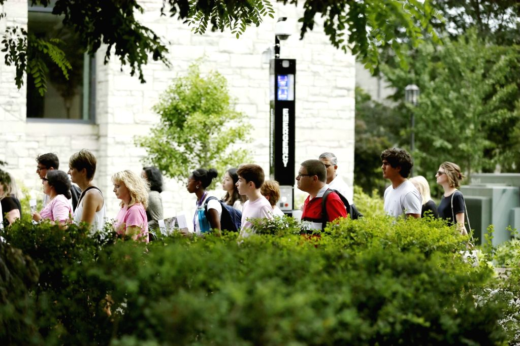 CHICAGO, Aug. 16, 2017 - Photo taken on July 26, 2017 shows people walking past an emergency call box on the campus of Northwestern University in Chicago, the United States. Evanston is a small city ...