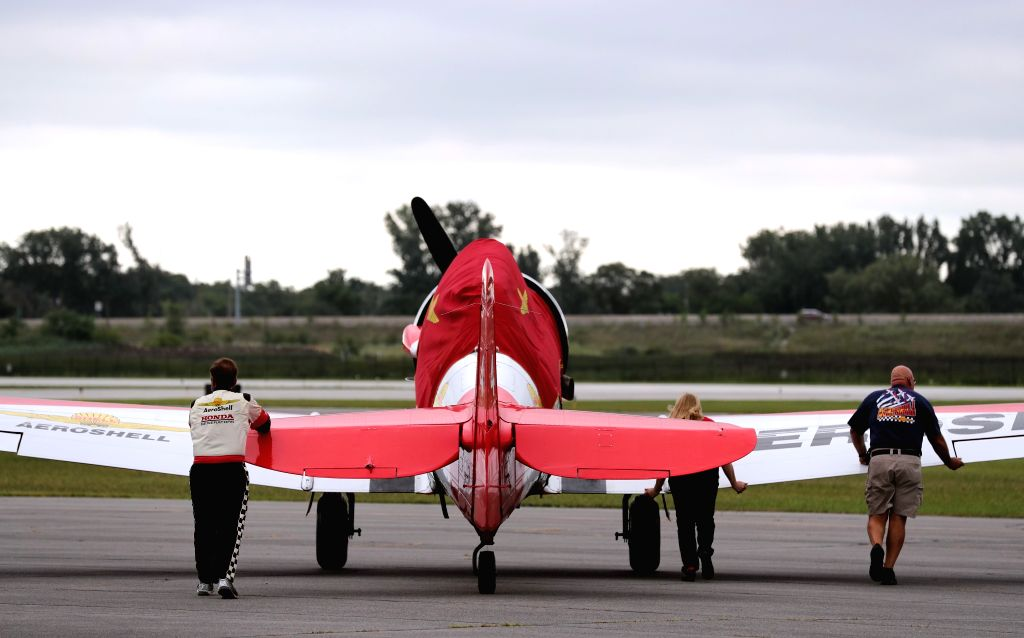 CHICAGO, Aug. 18, 2017 - Ground crew pushes an aerobatics plane to runway at Gary Jet Center, Chicago, the United States, Aug. 17, 2017. The Media Day for the 59th Annual Chicago Air and Water Show ...