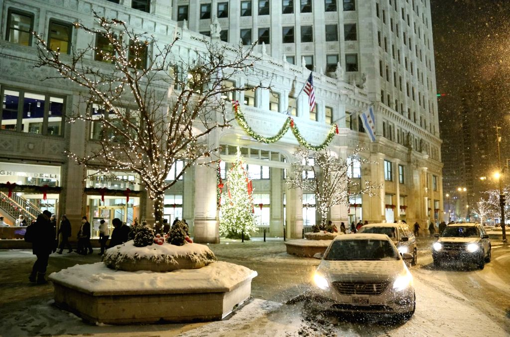 CHICAGO, Dec. 30, 2017 (Xinhua) -- Road and vehicles are covered with snow in downtown Chicago, the United States, Dec. 29, 2017. Snow continued to fall on Friday in Chicago area with temperature below minus 10 Celsius degrees. The snow and cold were