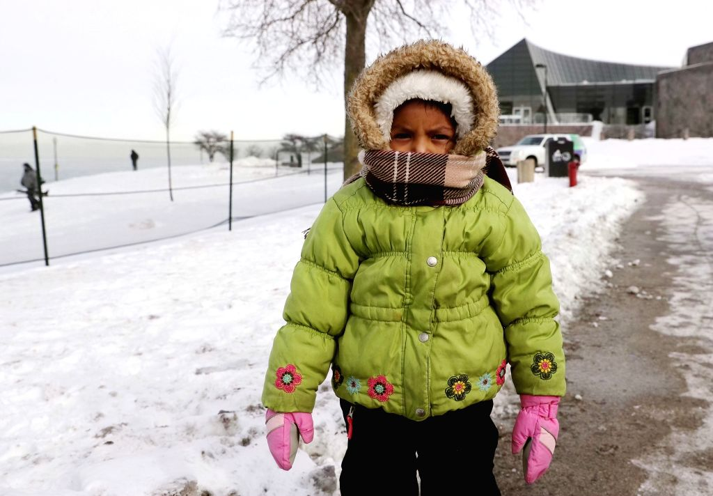 CHICAGO, Feb. 1, 2019 - A child is bundled up for cold winter weather in Chicago, the United States, Jan. 31, 2019. Chicago, the biggest city in the U.S. Midwest, was struck by the polar vortex with ...