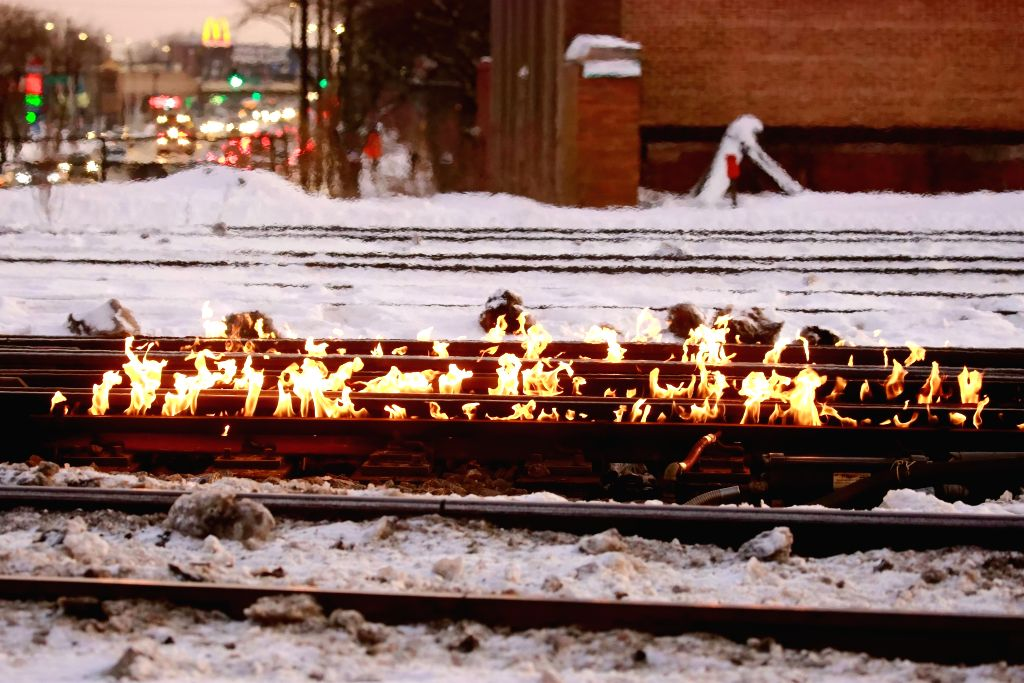 CHICAGO, Feb. 2, 2019 - Railway tracks are set on fire to ensure safety running for Metra trains at Western Avenue station in Chicago, the United States, on Feb.1, 2019. Chicago's railway system uses ...