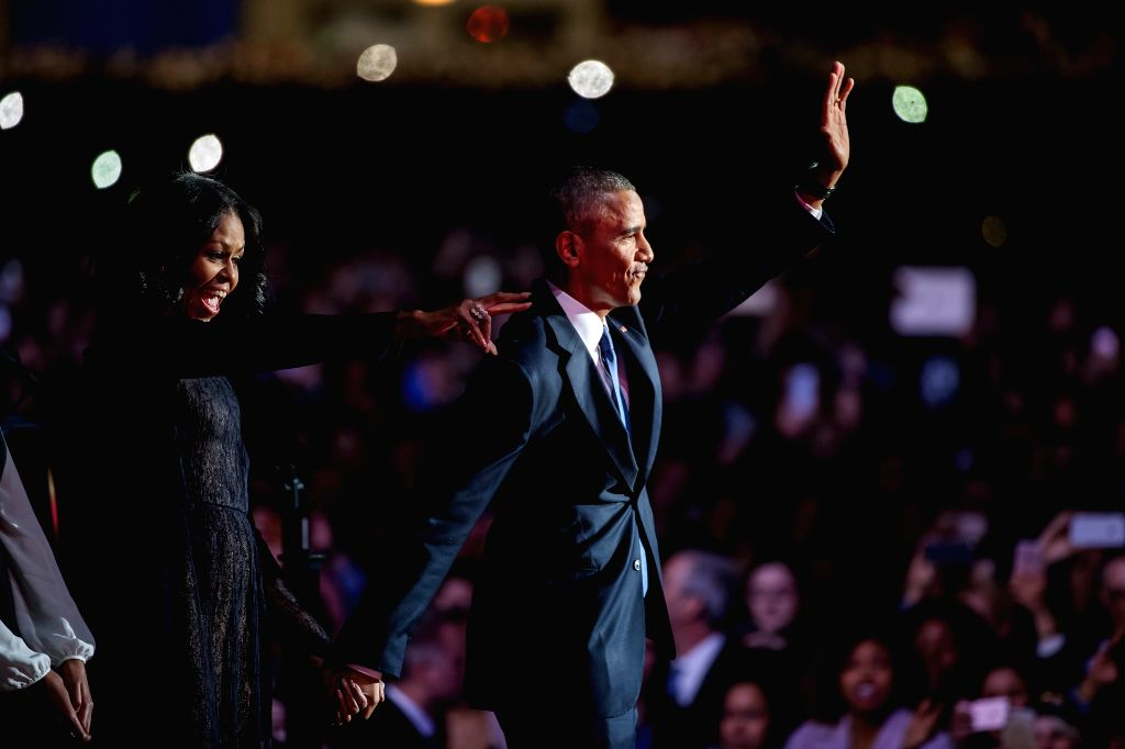 CHICAGO, Jan. 11, 2017 - U.S. President Barack Obama (R) waves to the audience with First Lady Michelle Obama after delivering his farewell address in Chicago, Illinois, United States of America on ...