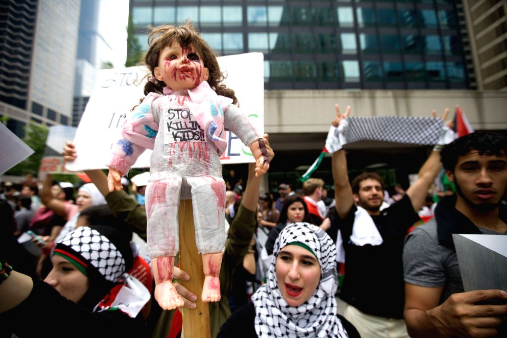 About 300 pro-Palestinian demonstrators protest against the recent deaths of children in the Gaza Strip after Israeli airstrikes, in Chicago, the United States, on .