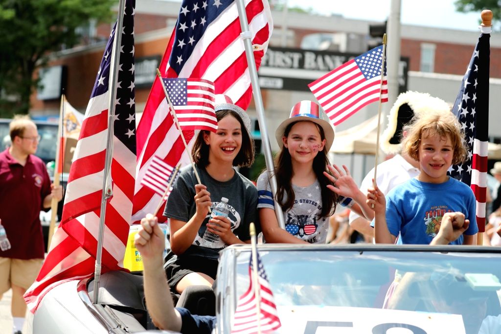 CHICAGO, July 5, 2018 - People take part in an Independence Day parade in Evanston in the suburbs of Chicago, the United States, on July 4, 2018.