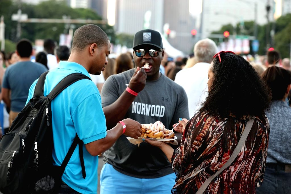 "CHICAGO, July 7, 2017 - Visitors share food during ""Taste of Chicago"" at Grant Park in Chicago, the United States, July 6, 2017. The five-day ""Taste of Chicago"" lasts from July 5 ..."