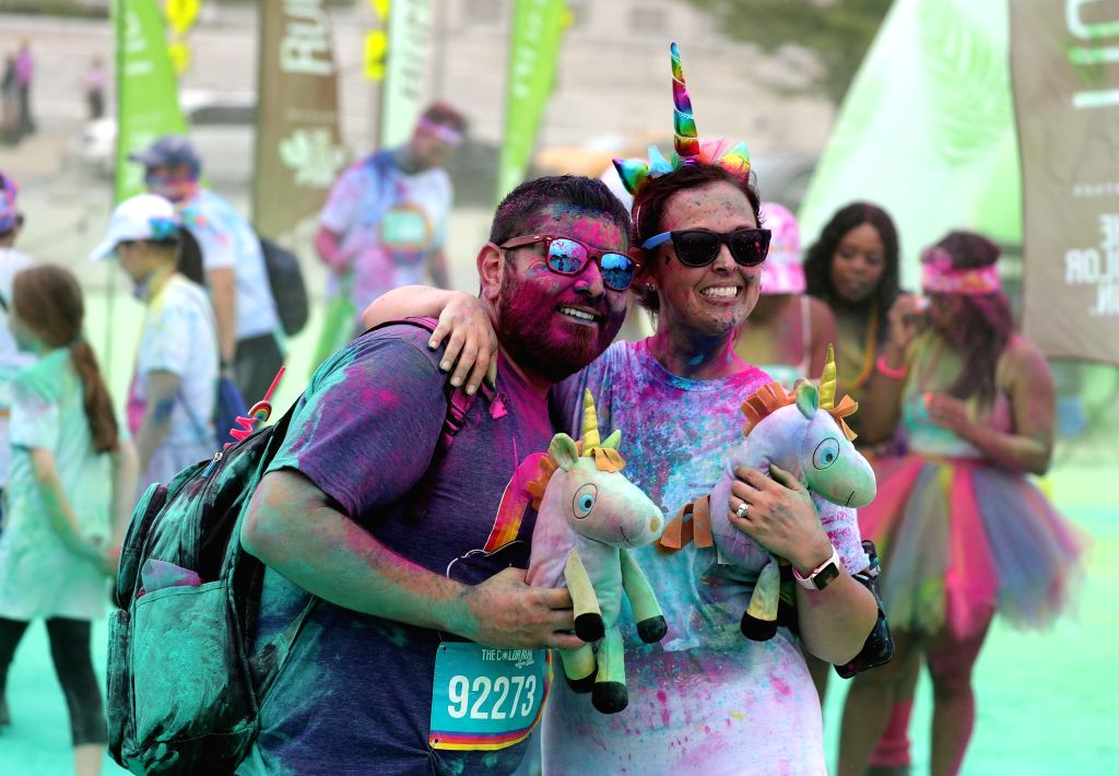 CHICAGO, June 15, 2019 - People pose for a photo during a color run event in Chicago, the United States, on June 15, 2019. The color run is a five-kilometer event with over one thousand participants ...