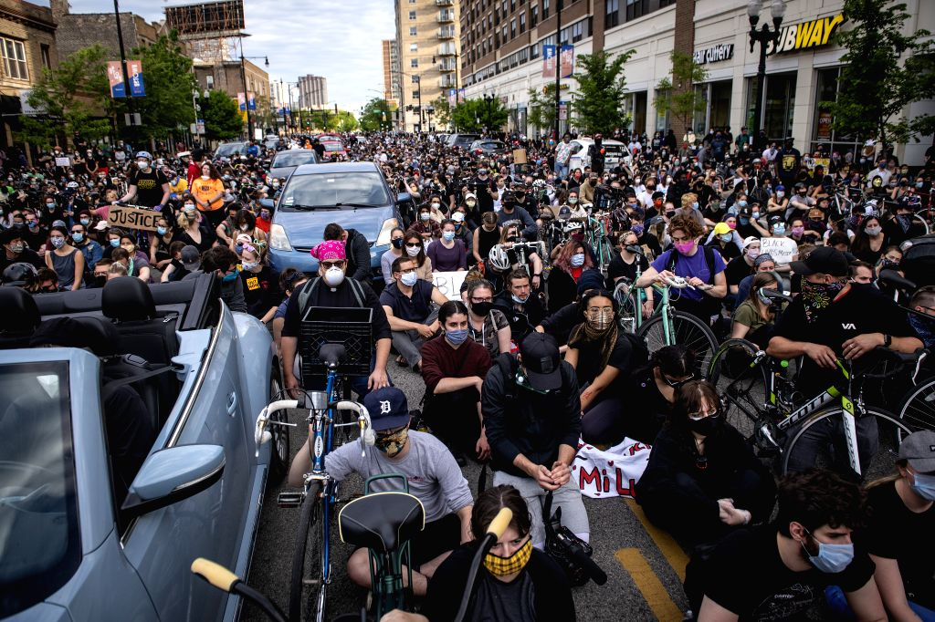 CHICAGO, June 2, 2020 (Xinhua) -- Demonstrators take part in a protest in Uptown neighborhood of Chicago, the United States, June 1, 2020. Two people were shot dead and at least 60 were arrested as protests and looting continued in Chicago neighborho