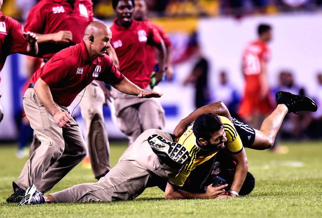 CHICAGO, June 23, 2016 - A fan is tackled by security during the Copa America Centenario semifinal football match between Chile and Colombia in Chicago, Illinois, the United States, on June 22, 2016. ...