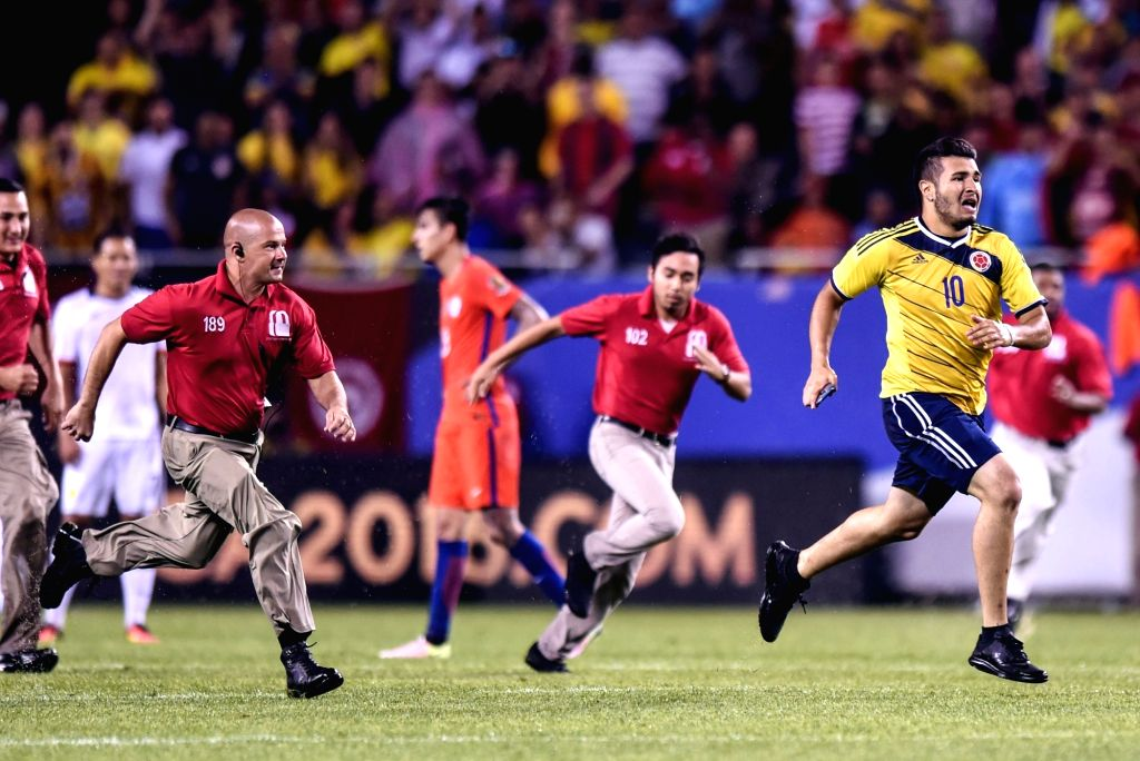 CHICAGO, June 23, 2016 - A fan runs onto the field during the Copa America Centenario semifinal football match between Chile and Colombia in Chicago, Illinois, the United States, on June 22, 2016. ...