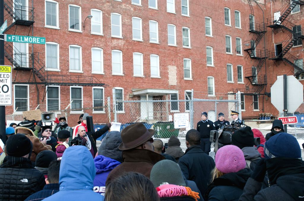 "Protestors participate in an assembly before the alleged ""black site"" Homan Square, west of Chicago, the United States, on Feb. 28, 2015. The Guardian ..."