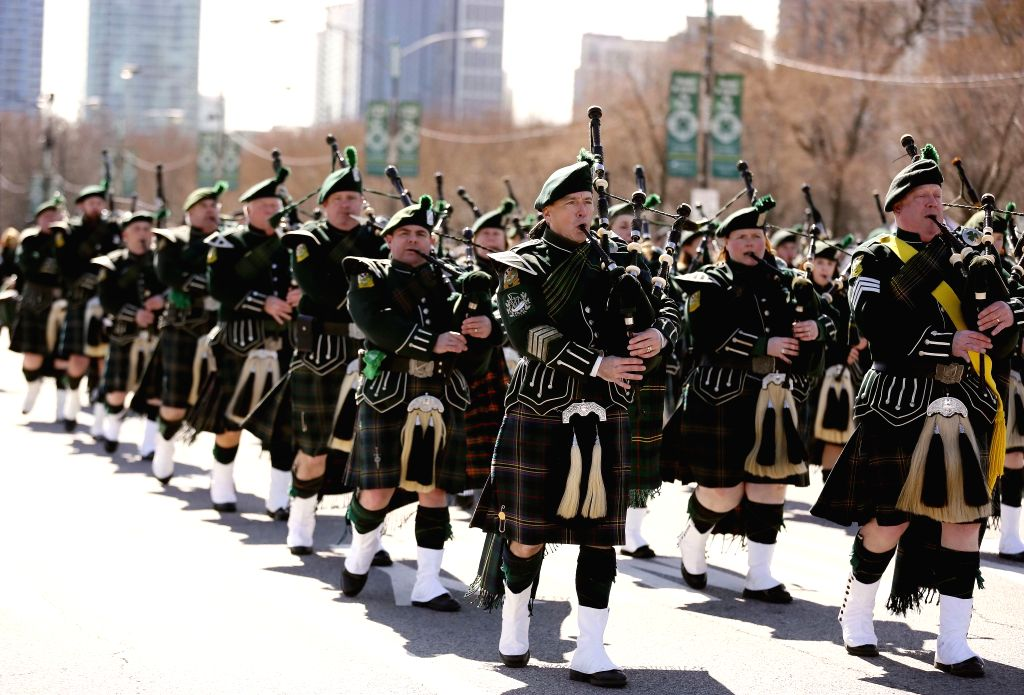 CHICAGO, March 12, 2017 - People take part in the annual St. Patrick's Day Parade in downtown Chicago, the United States, March 11, 2017. St. Patrick's Day is just around the corner and Chicago has ...