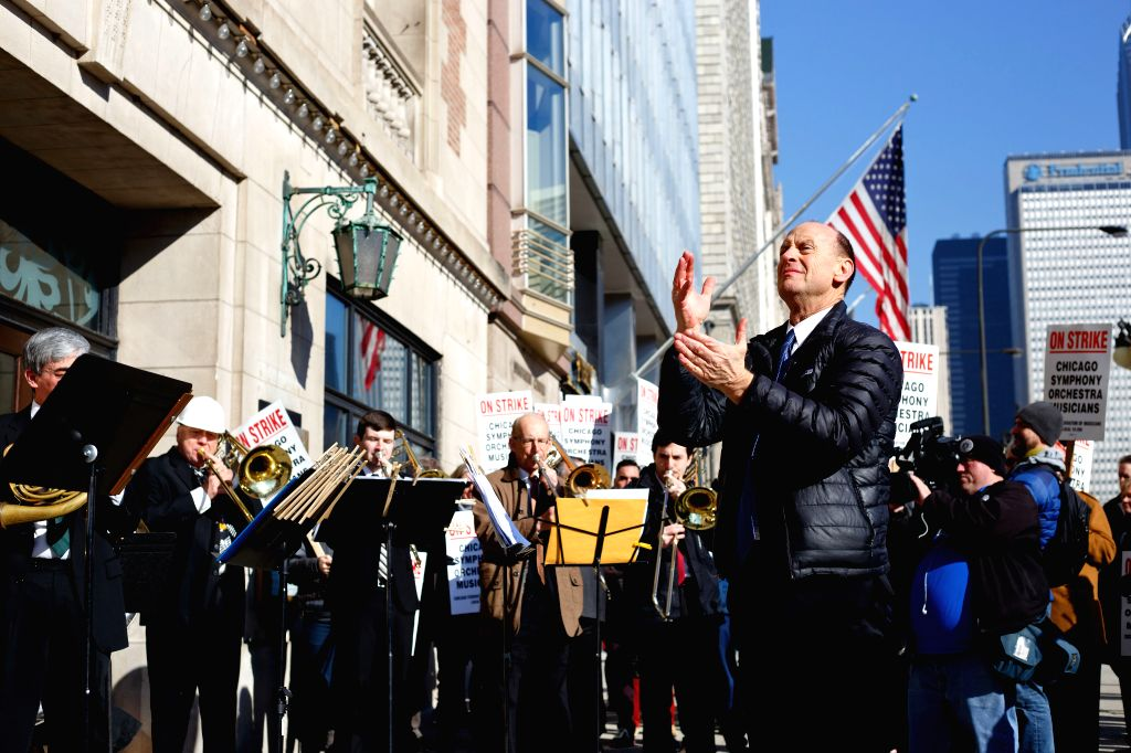 CHICAGO, March 13, 2019 - Musicians of the Chicago Symphony Orchestra (CSO) and other supporters participate in a strike in Chicago, the United States, on March 12, 2019. The CSO musicians went on a ...