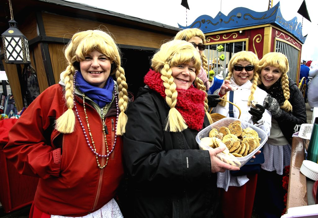 CHICAGO, March 3, 2019 - Participants dressed with wigs pose during the CHIditarod XIV in Chicago, Illinois, the United States, on March 2, 2019. Chicago hosts CHIditarod in March every year, aiming ...