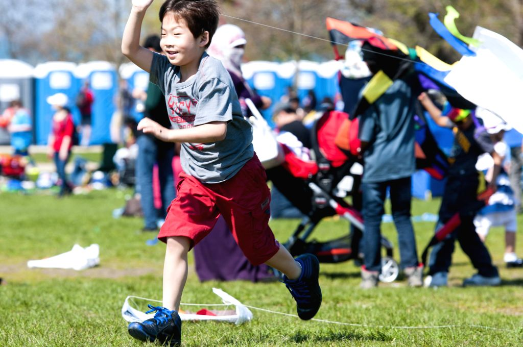 A boy flies a kite on Cricket Hill in Chicago, the United States on May 2,2015. The annual Kids and Kites festival, organized by the Department of Cultural Affairs ...