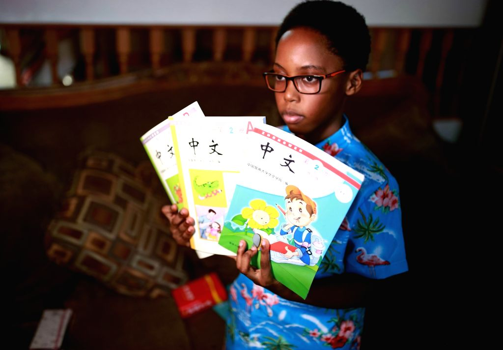 CHICAGO, Oct. 16, 2019 - Khaya Njumbe shows his Chinese-learning textbooks in Chicago, the United States, on Sept. 25, 2019. Ten-year-old Khaya Njumbe has been studying Chinese for years, so that ...