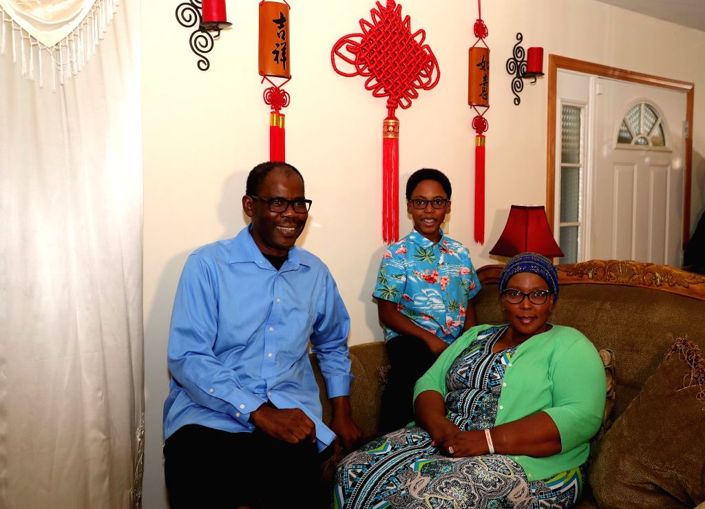 CHICAGO, Oct. 16, 2019 - Photo taken on Sept. 25, 2019 shows Khaya Njumbe (C) with his parents in Chicago, the United States. Ten-year-old Khaya Njumbe has been studying Chinese for years, so that ...