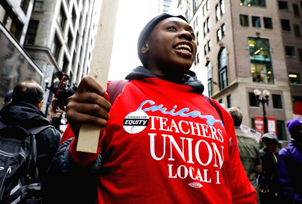 CHICAGO, Oct. 17, 2019 - A teacher takes part in the Chicago Teachers' Union strike rally in downtown Chicago, the United States, on Oct. 17, 2019. Thousands of teachers and supporters rally on ...