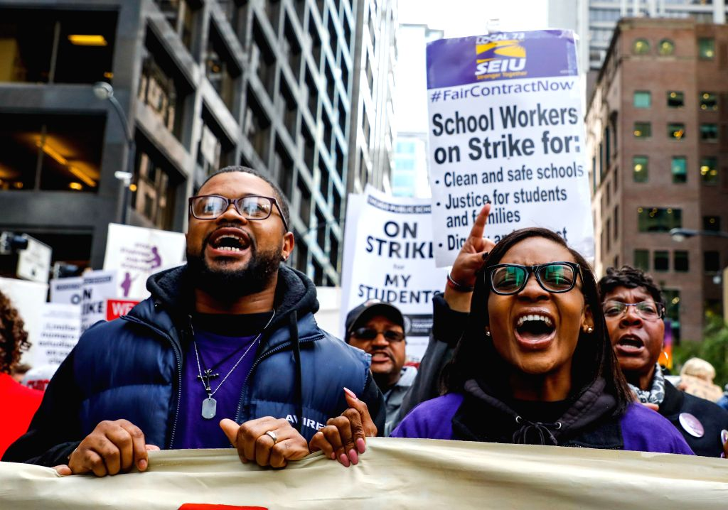 CHICAGO, Oct. 17, 2019 - Teachers march during the Chicago Teachers' Union strike rally in downtown Chicago, the United States, on Oct. 17, 2019. Thousands of teachers and supporters rally on ...
