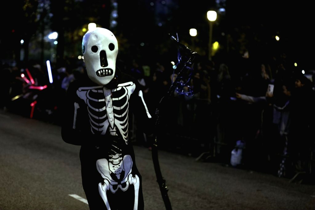 CHICAGO, Oct. 23, 2016 - A participant attends a Halloween parade organized by Chicago Cultural Mile Association in Chicago, the United States, Oct. 22, 2016. Hundreds of people dressed in Halloween ...