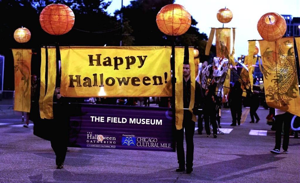 CHICAGO, Oct. 23, 2016 - People attend a Halloween parade organized by Chicago Cultural Mile Association in Chicago, the United States, Oct. 22, 2016. Hundreds of people dressed in Halloween costumes ...