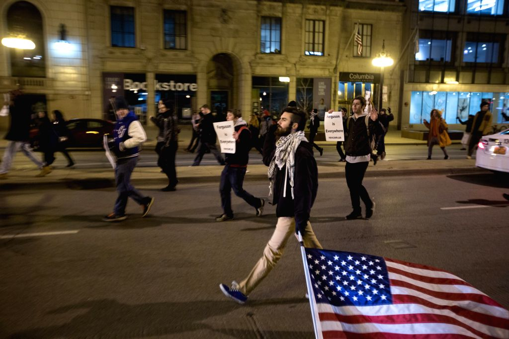 Protesters march in a street of Chicago on night of Dec. 4, 2014, to demonstrate concerns over the chokehold death of a black man caused by a white police officer of the New York City Police