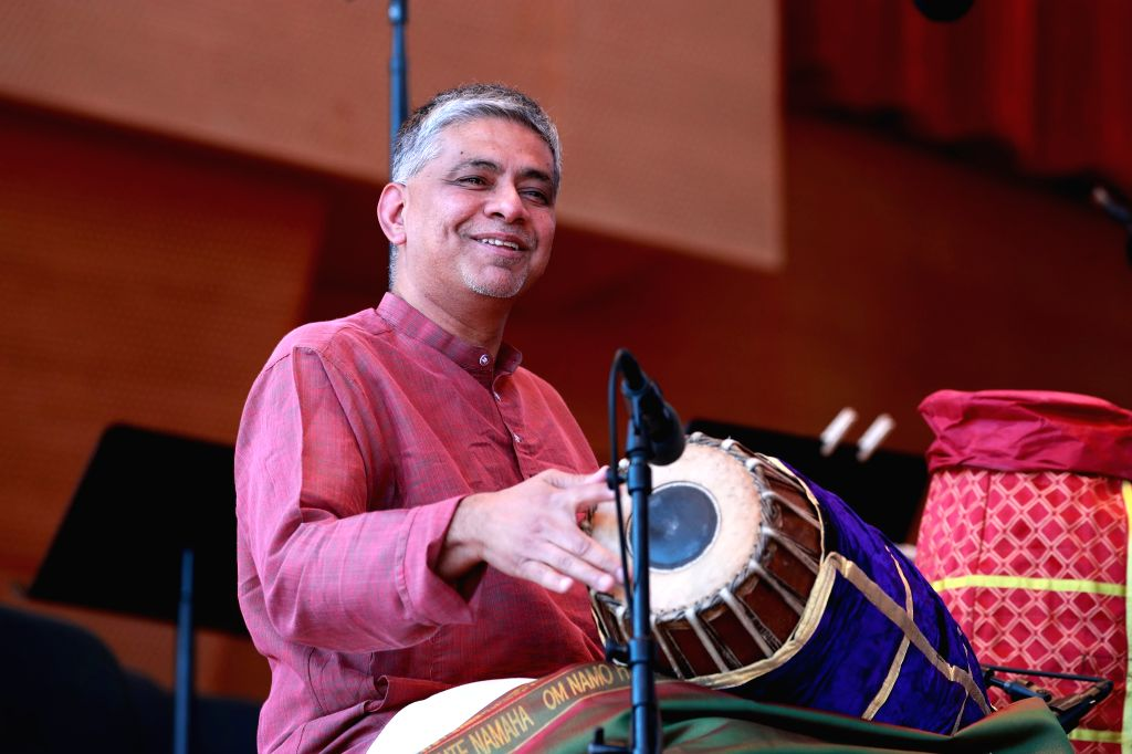 CHICAGO, Sept. 10, 2017 - Indian mridangam player Mahesh Krishnamurthy performs during the annual World Music Festival in Chicago, the United States, on Sept. 9, 2017.