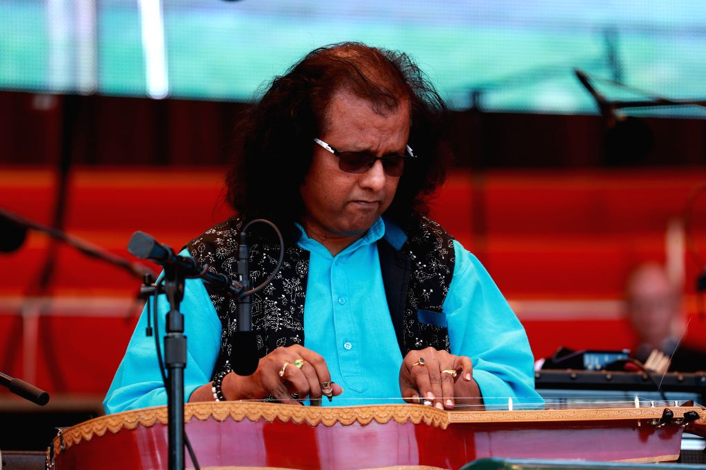 CHICAGO, Sept. 10, 2017 - Indian slide guitar player Debashish Bhattacharya performs during the annual World Music Festival in Chicago, the United States, on Sept. 9, 2017.