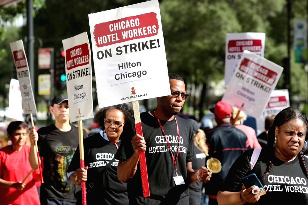 CHICAGO, Sept. 12, 2018 - Workers of Hilton Chicago participate in a strike demanding year-round health insurance in front of the hotel in Chicago, the United States, Sept. 12, 2018. Thousands of ...
