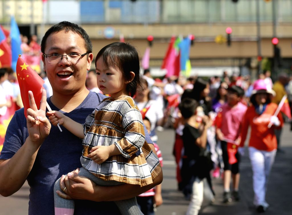 CHICAGO, Sept. 16, 2019 - People participate in a parade to celebrate the upcoming Chinese National Day in Chinatown of Chicago, the United States, on Sept.15, 2019.