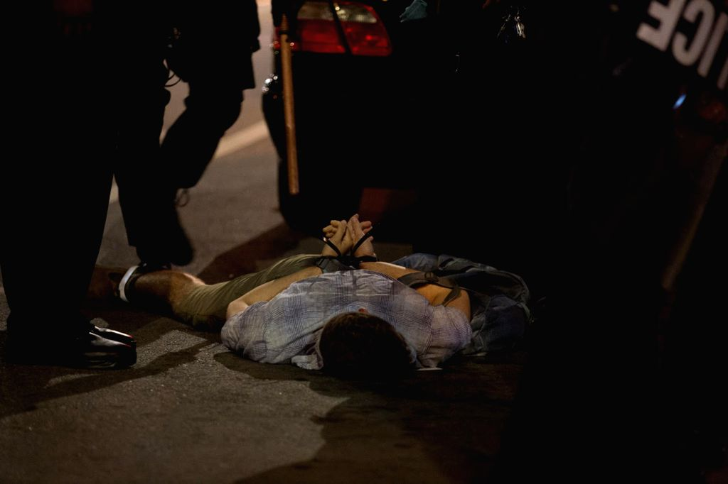 CHICAGO, Sept. 17, 2017 - A student from Washington University is arrested in St. Louis, Missouri, the United States, Sept. 16, 2017. Police on Saturday put up barricades around the courthouse and ...