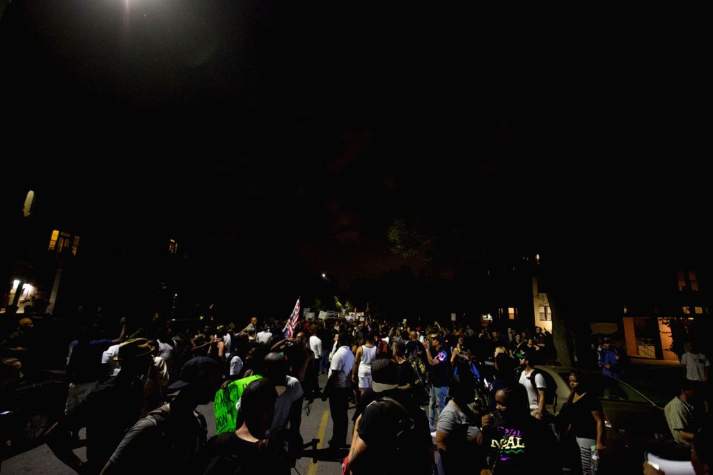 CHICAGO, Sept. 17, 2017 - Demonstrators march in St. Louis, Missouri, the United States, Sept. 16, 2017. Police on Saturday put up barricades around the courthouse and police headquarters in St. ...