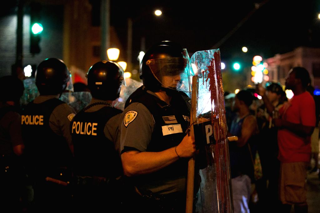 CHICAGO, Sept. 17, 2017 - Police guard as protestors march in St. Louis, Missouri, the United States, Sept. 16, 2017. Police on Saturday put up barricades around the courthouse and police ...