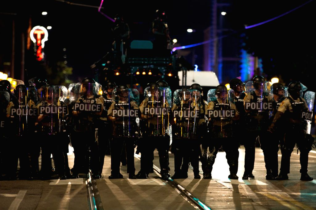 CHICAGO, Sept. 17, 2017 - Police line marches towards demonstrators in St. Louis, Missouri, the United States, Sept. 16, 2017. Police on Saturday put up barricades around the courthouse and police ...
