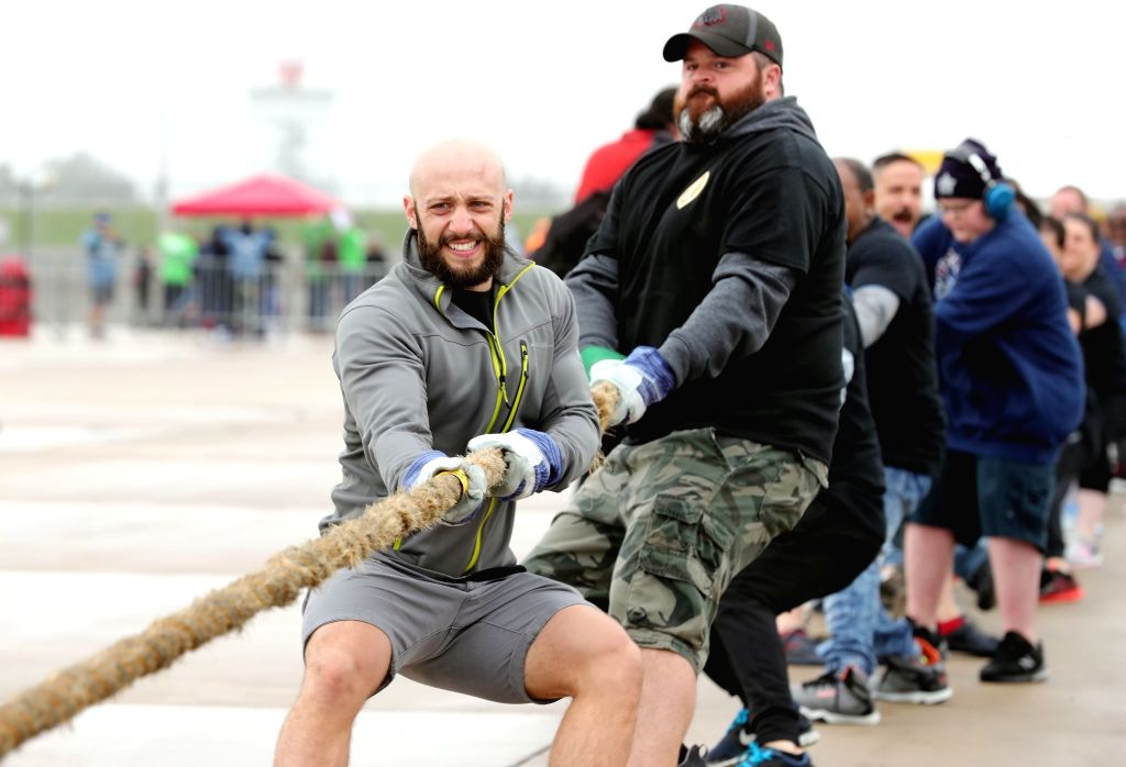 CHICAGO, Sept. 29, 2019 - People participate in Plane Pull at O'Hare International Airport in Chicago, the United States, Sept. 28, 2019. Participants in groups were required to pull a plane weighing ...