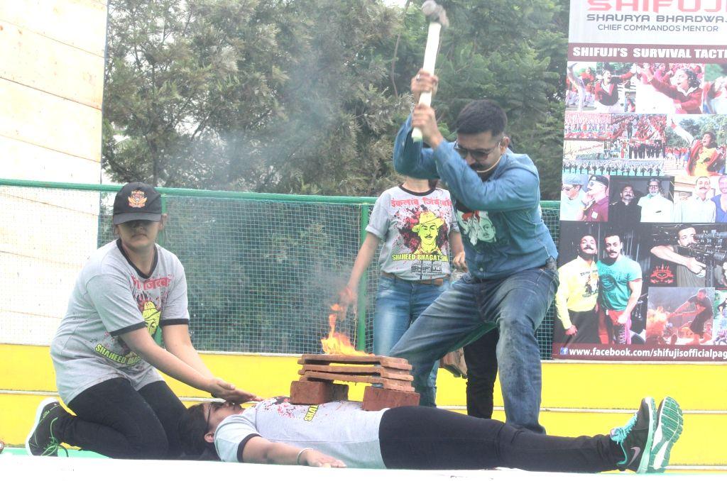 Chief commando trainer Grandmaster Shifuji Shaurya Bharadwaj demonstrate an unarmed combat and self discipline training programma for women during the two day workshop in Bengaluru, on ...