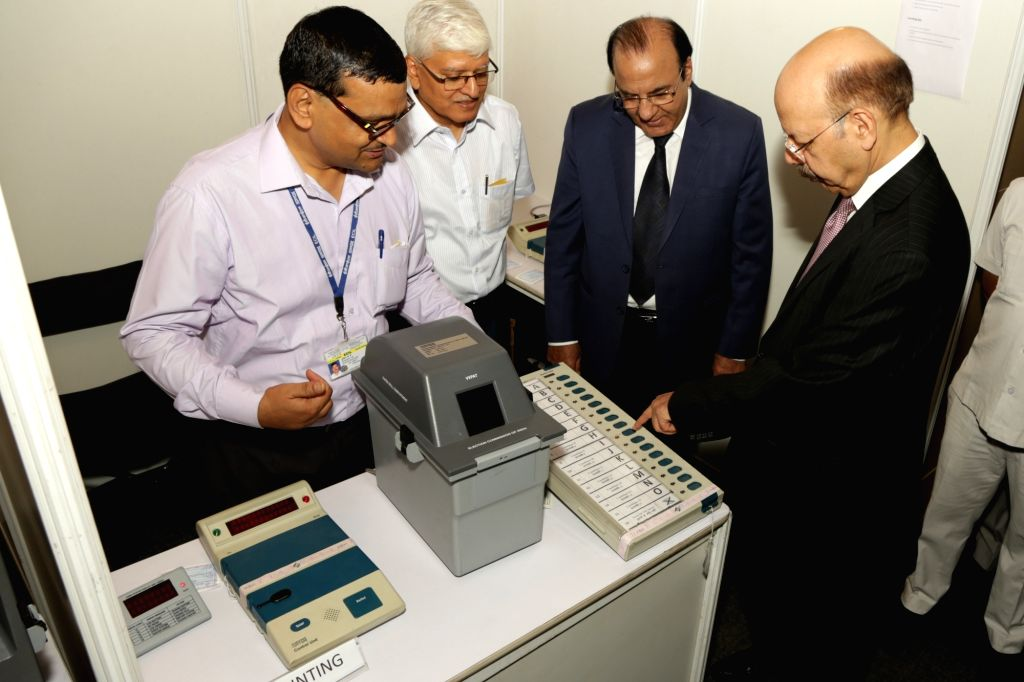 "Chief Election Commissioner Nasim Zaidi inspects the Electronic Voting Machines and Voter-verifiable paper audit trail (VVPAT) during a press conference on ""EVM Challenge"" called ..."