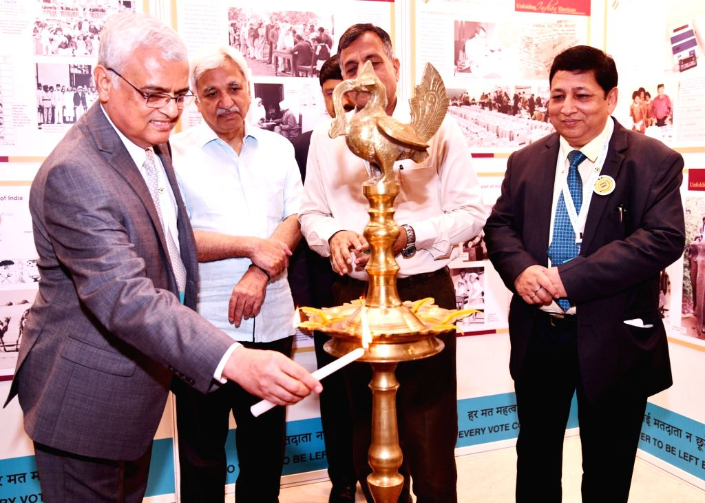 """Chief Election Commissioner O.P. Rawat inaugurates an exhibition on """"Inclusion of Persons with Disabilities (PwDs) in the Electoral Process"""" , in New Delhi on July 3, 2018. Also ... - Commissioners Sunil Arora"""